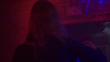 Two woman dance in night club