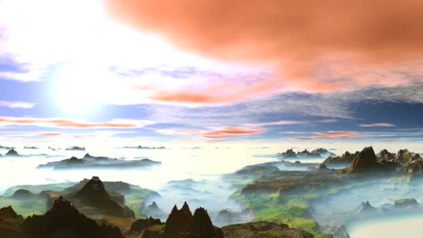 Beautiful Spring Sunset over the Misty Mountains. In the blue sky, white and pink clouds float. Bright sun slowly sets. The mountains and green valleys are covered with a thick white mist.