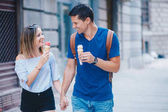 young couple having date in city street