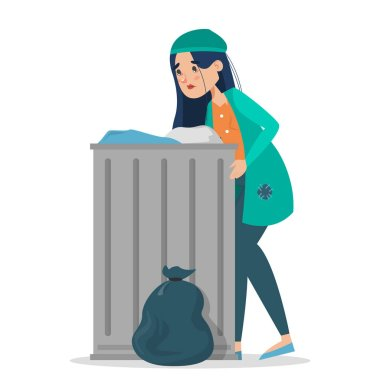 Homeless woman in dirty clothes standing at the trash can