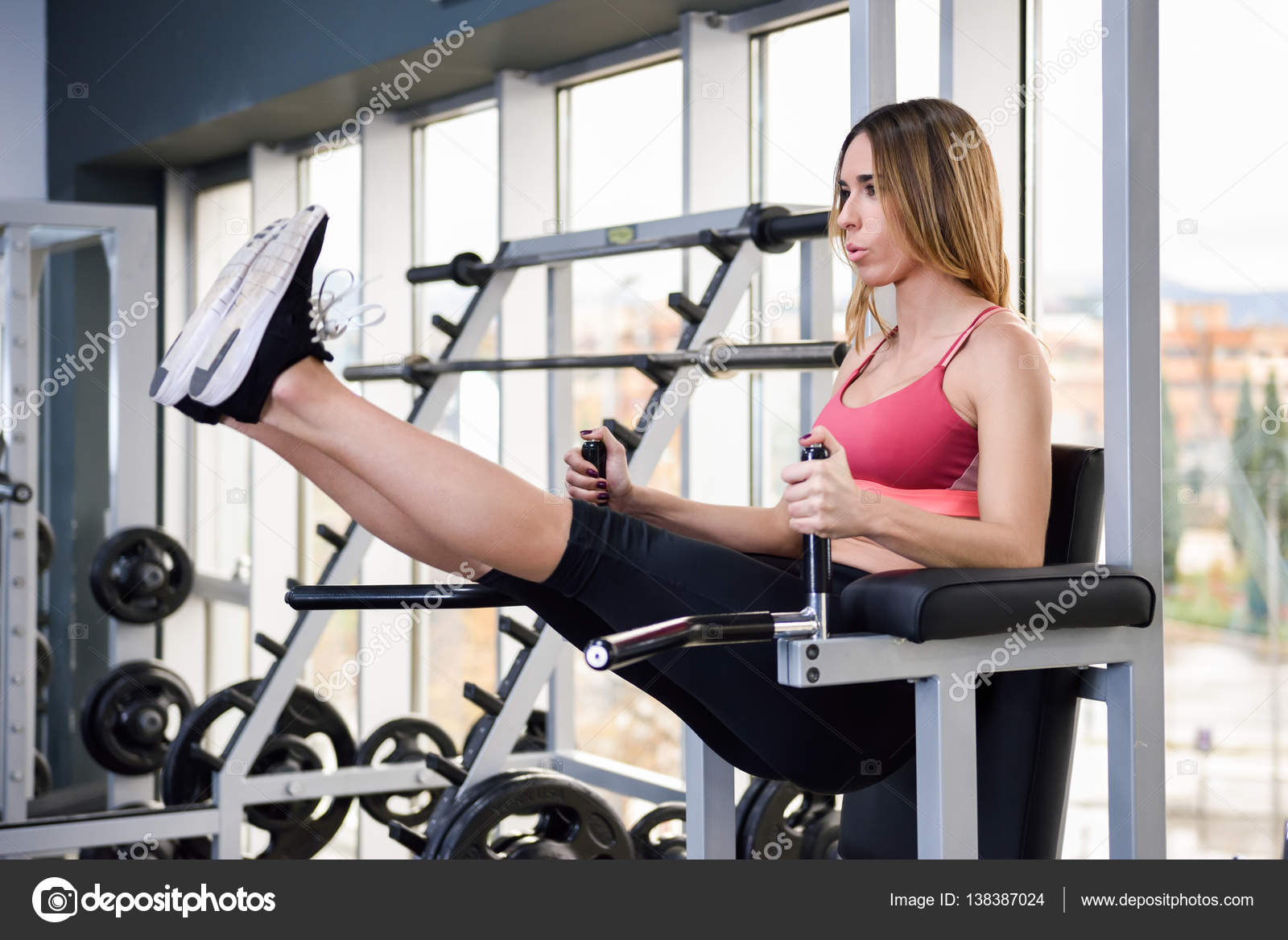 Young Fit Woman At The Gym Doing Abs Workout Stock Photo