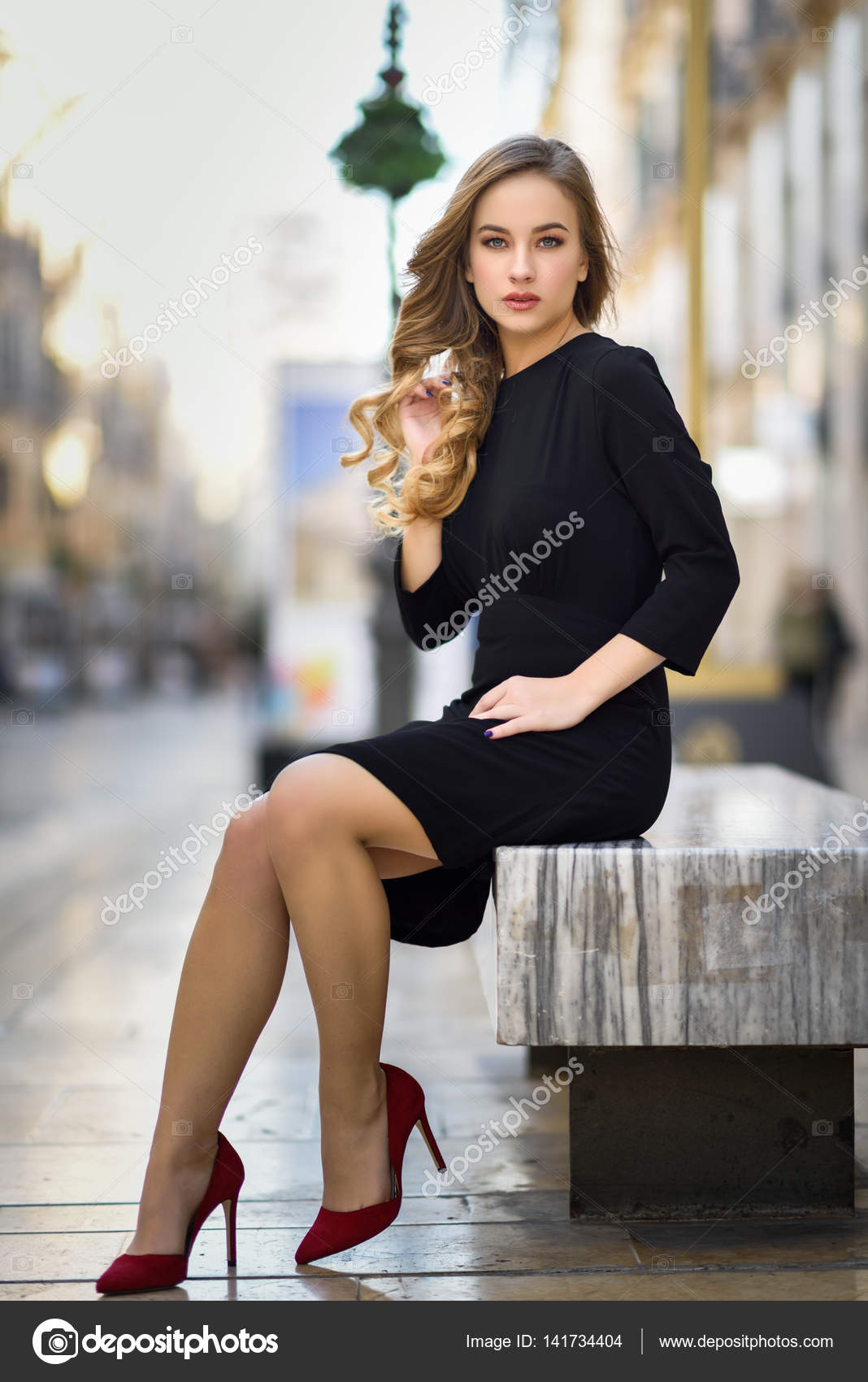 Beautiful Blonde Russian Woman In Urban Background Stock