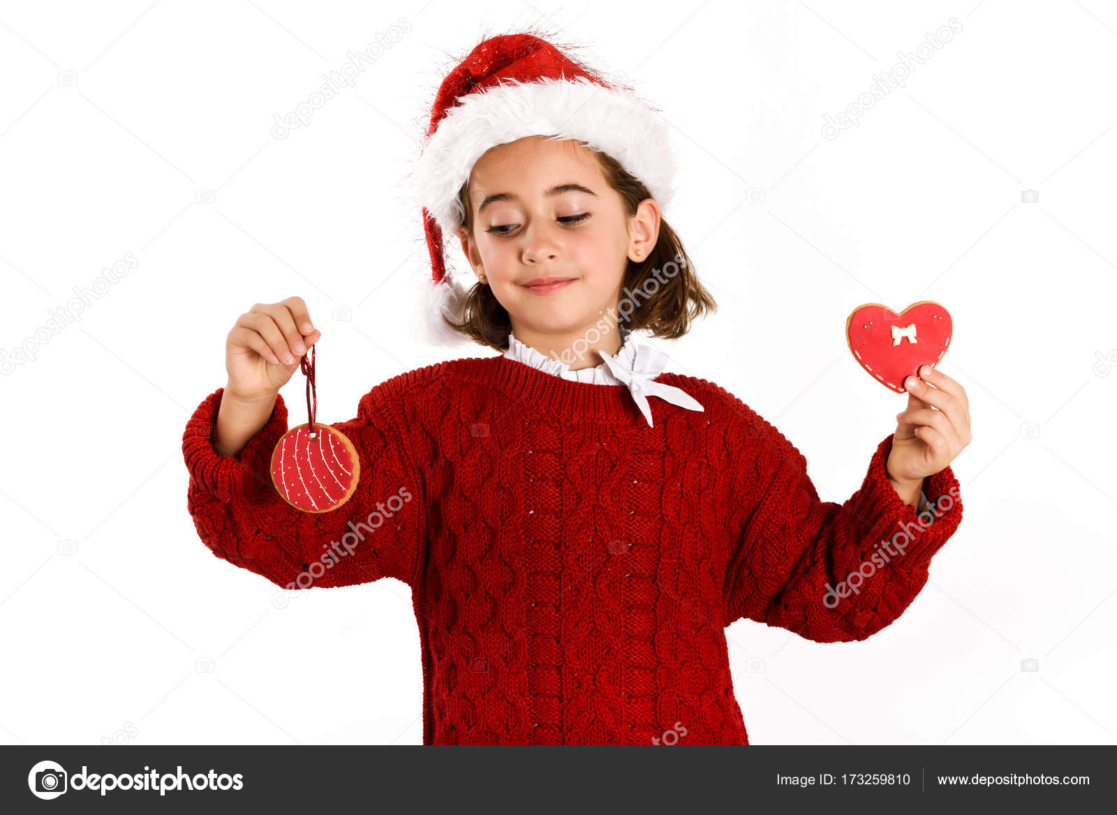 2d6454aa789a Adorable little girl wearing santa hat with Christmas biscuits isolated on white  background. Winter clothes — Photo by ...