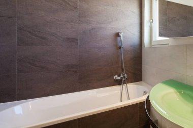 Bathroom interior nterior with tiled walls