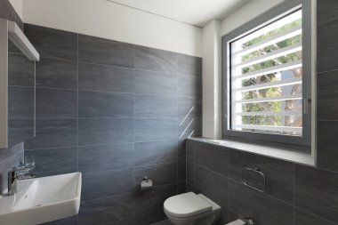 Interior of a modern house, gray bathroom