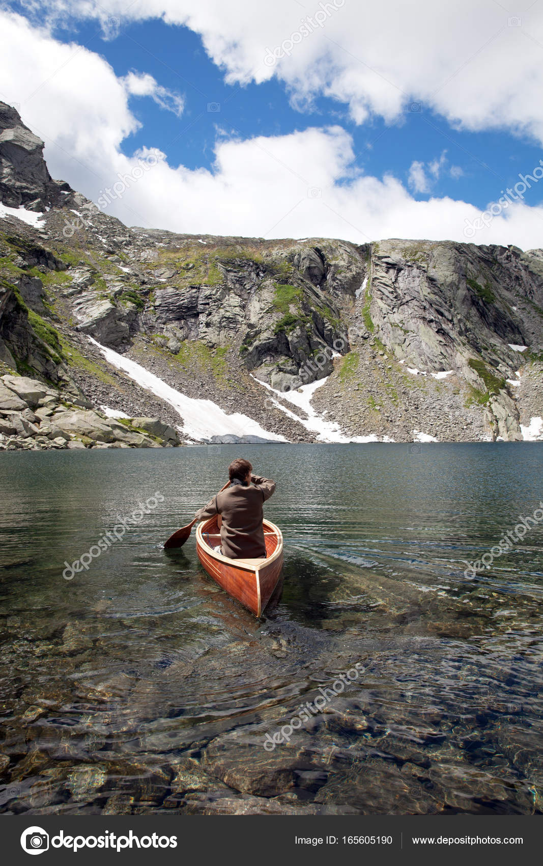 Wooden Canoe In The Middle Of Water Stock Photo