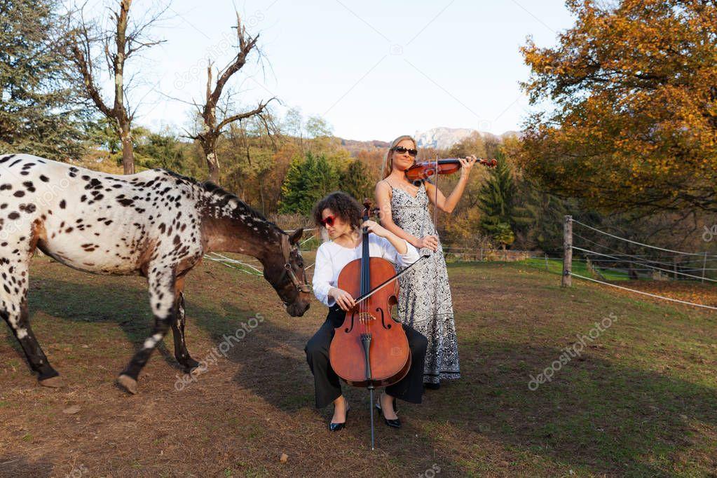 Portrait of a women musician, outdoors