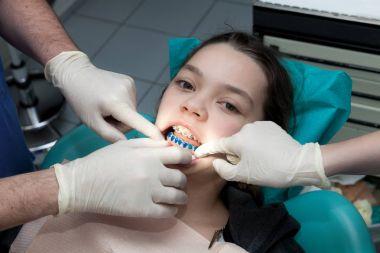 Girl by her dentist