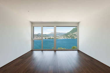 empty room with window overlooking the lake