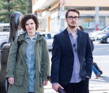Pair of musicians walking in the street