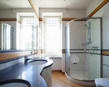 Modern bathroom with large mirror