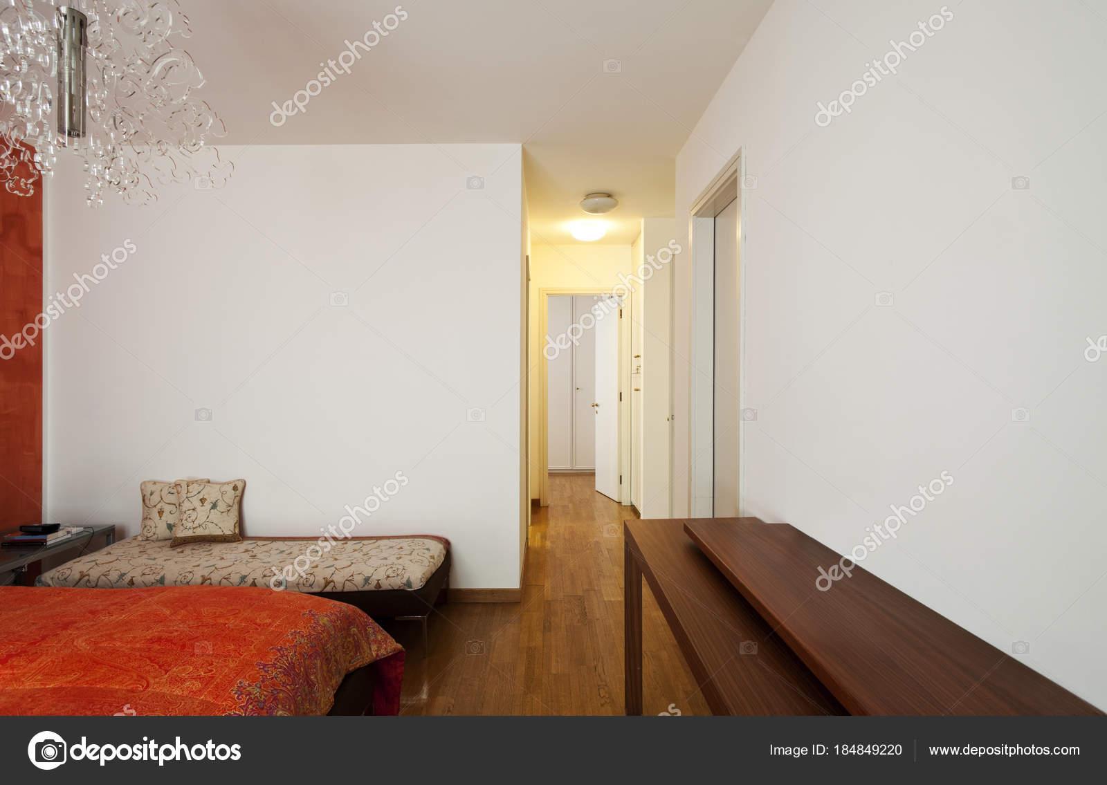 Orange and white bedroom interior — Stock Photo © Zveiger #184849220