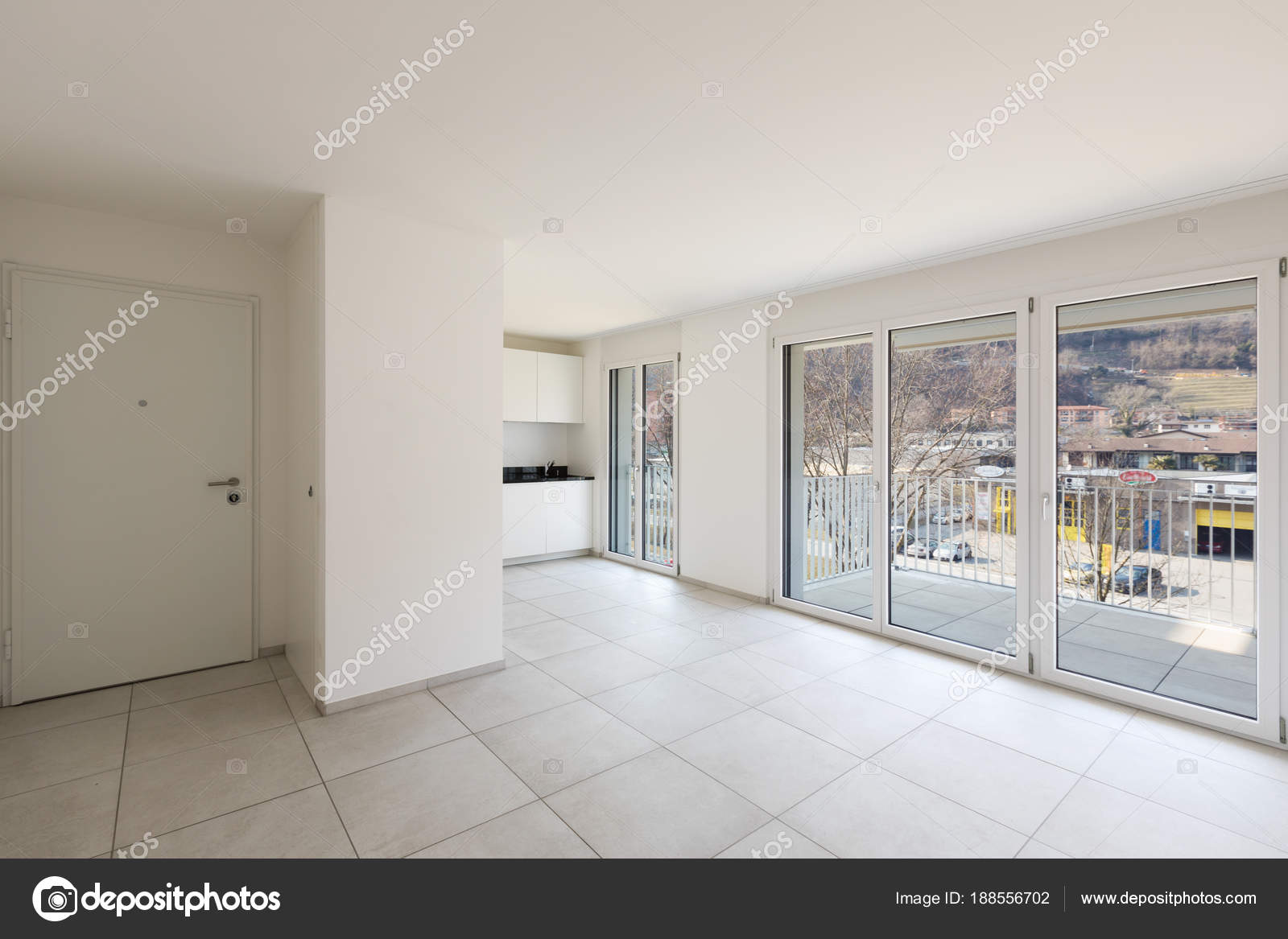 Empty living room with large windows — Stock Photo © Zveiger #188556702