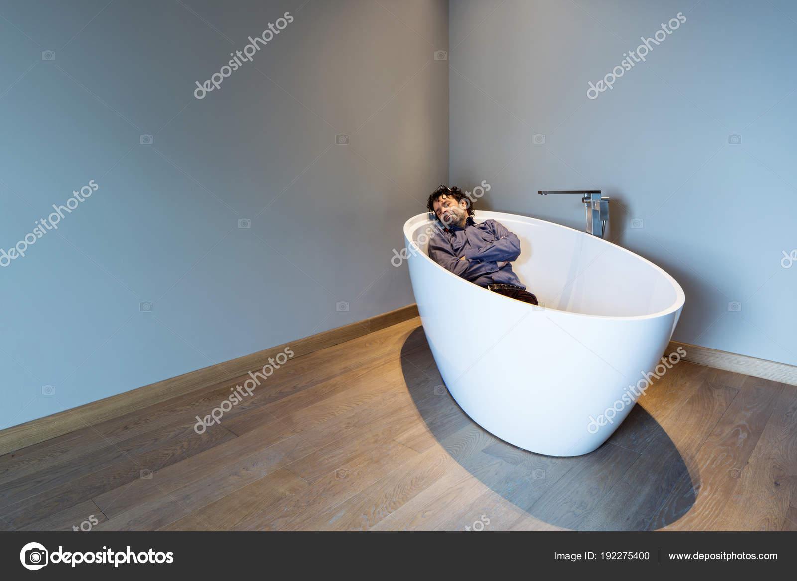 Man inside a luxury bathtub in modern apartment — Stock Photo ...