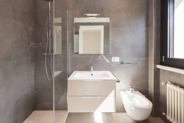 Modern bathroom with large tiles