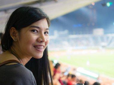 women looking for football in stadium