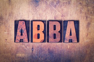 Abba Theme Letterpress Word on Wood Background