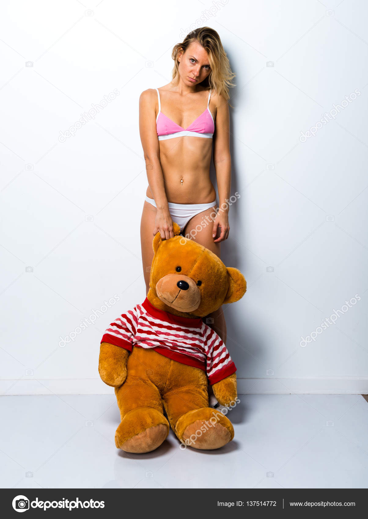 Sexy blonde girl in underwear with big stuffed animal — Stock Photo