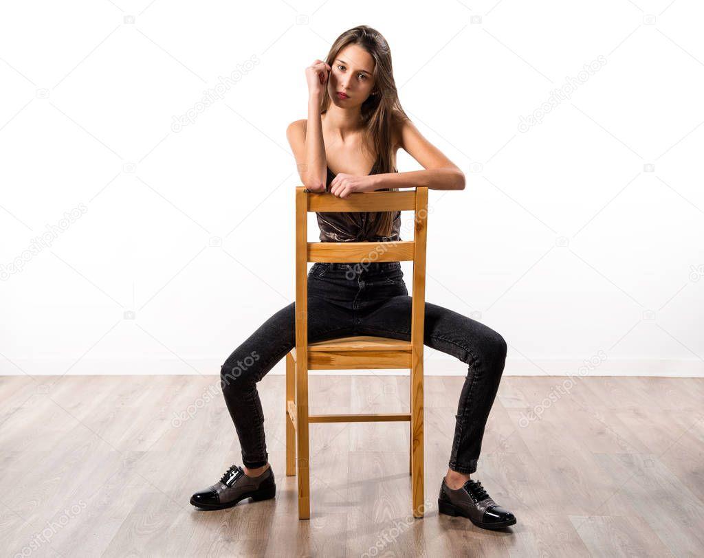 Tan girl posing on chair — img 11