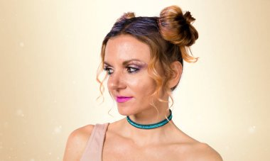 Pretty girl with fashion make up on ocher background