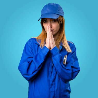 Delivery woman pleading on colorful background