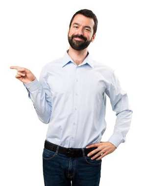 Handsome man with beard pointing to the lateral