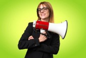 Photo Young business woman holding a megaphone on colorful background