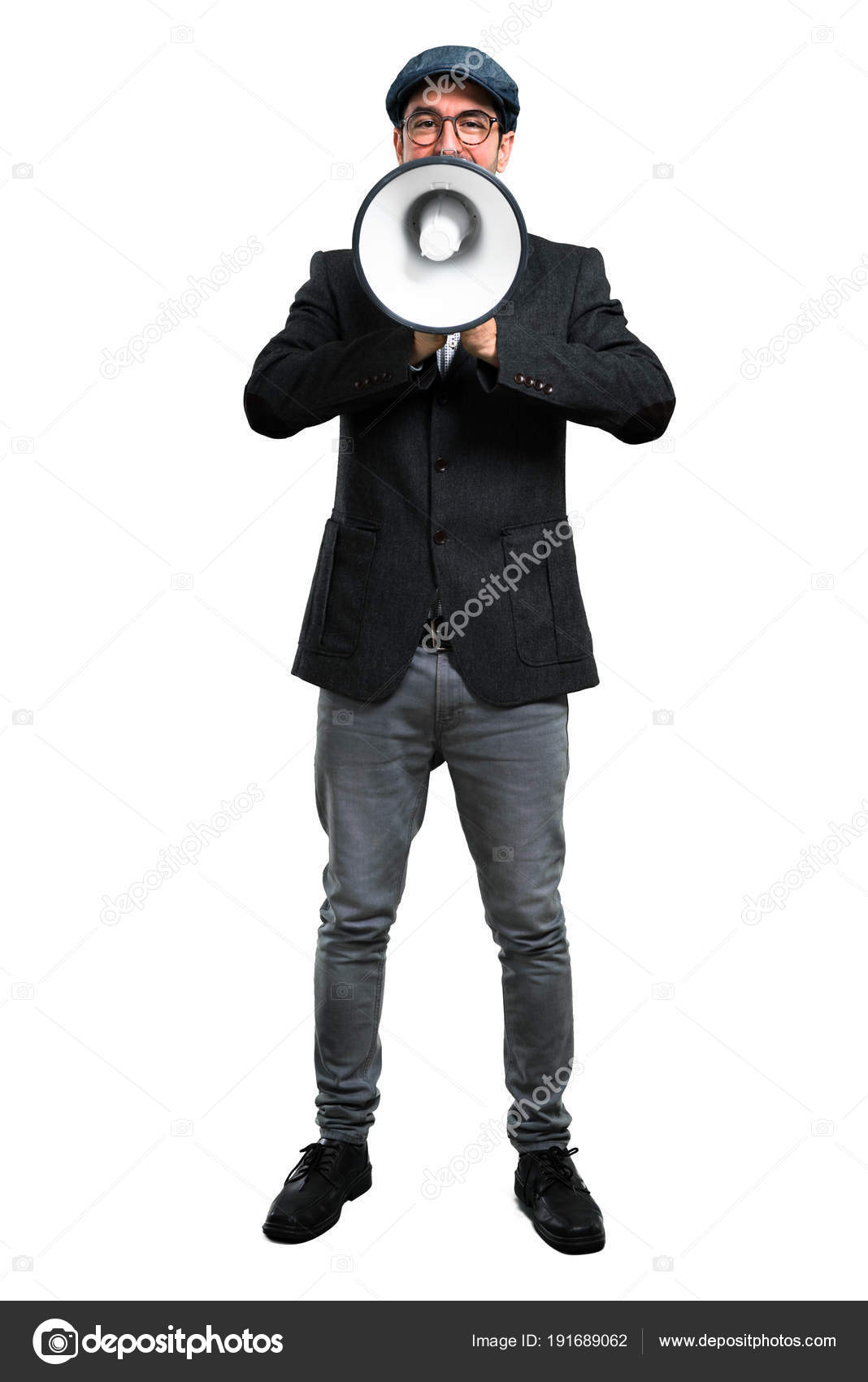 0a4e3cc4f4c7b Handsome modern man with beret and glasses holding a megaphone — Stock Photo