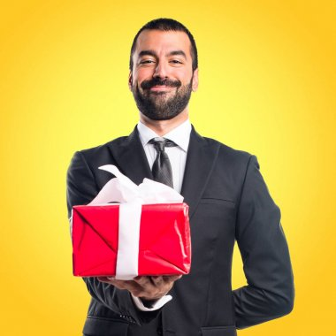 Businessman holding a gift stock vector