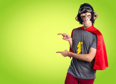 Superhero monkey man pointing to the lateral