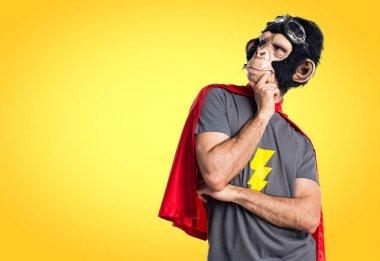 Superhero monkey man thinking