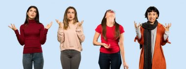 Set of women over isolated blue background frustrated by a bad situation