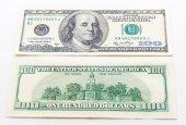 uno dollari di banconote su fondo bianco