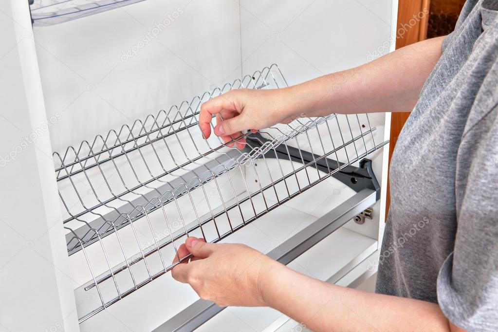 Installing wire dish rack for drying dishes inside kitchen cabinet ...