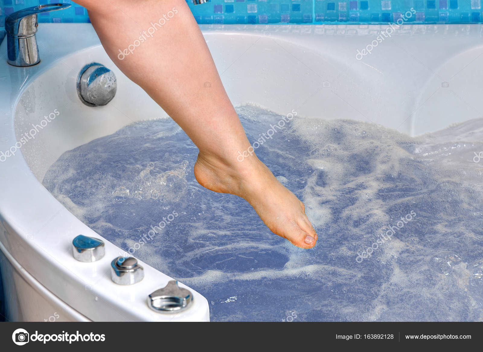 Female foot descends into the whirlpool bath, close-up. — Stock ...