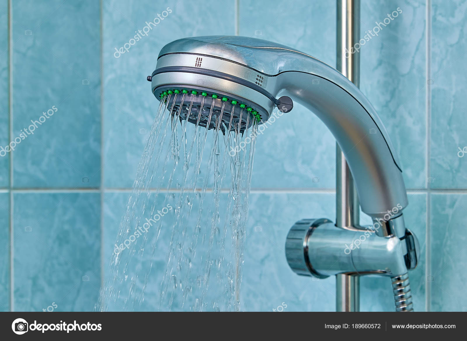 Water flows from shower head inside bathroom, fixed in holder ...