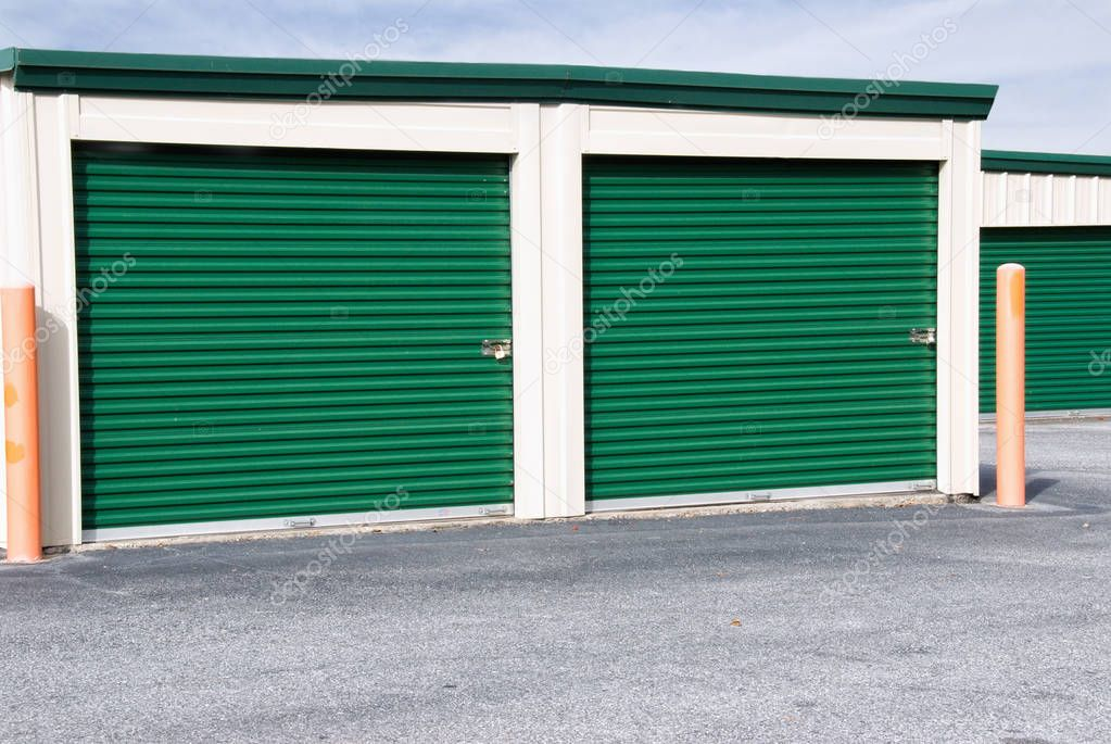 Mini Storage Warehouse Building with Green Doors