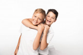 cheerful boy jokingly stifling smiling brother isolated on white