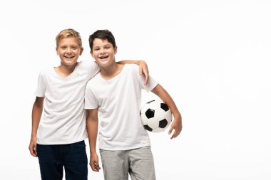 happy boy hugging brother holding soccer ball isolated on white
