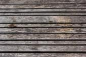hnědé texturované ošlehaný dřevěné pozadí s kopírovacím prostorem