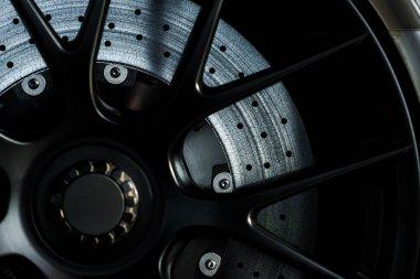 KYIV, UKRAINE - OCTOBER 7, 2019: close up of black modern car wheel in porshe stock vector