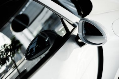 KYIV, UKRAINE - OCTOBER 7, 2019: selective focus of car mirror near car window in porshe stock vector