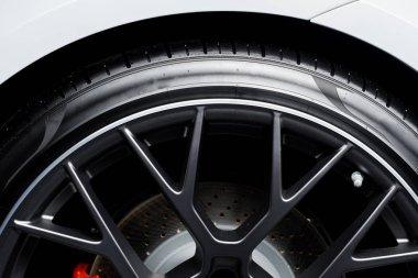 KYIV, UKRAINE - OCTOBER 7, 2019: close up of black car wheel in white porshe stock vector