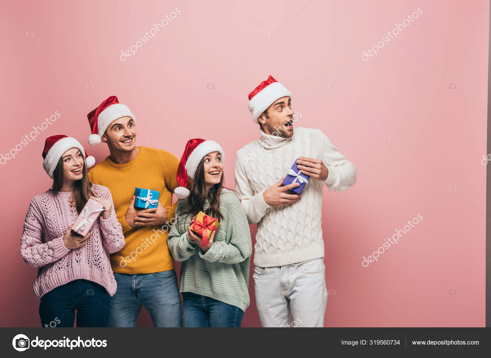 Happy Friends Santa Hats Holding Christmas Presents Isolated Pink