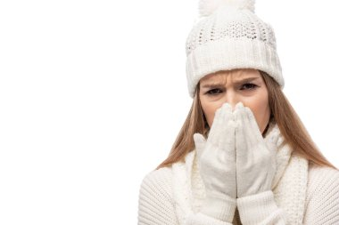Upset cold woman warming up in white knitted clothes, isolated on white stock vector