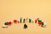 Toy gorilla with colored animals on yellow background, extinction of animals concept
