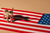 Golden toy elephant with shadow on american flag, animal welfare concept