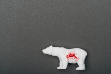 Top view of white toy bear with blood on grey background, killing animals concept stock vector