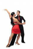 elegant dancers looking at each other while performing tango on white background
