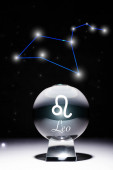 crystal ball with Leo zodiac sign isolated on black with constellation